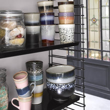 open shelf unit in black with pastel colored hk living usa ceramic bowls and mugs
