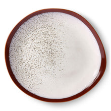 Dinner plate in organic shape in white and brown colors