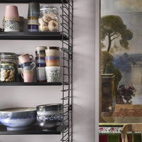 open shelving with 70's style ceramics by hk living usa