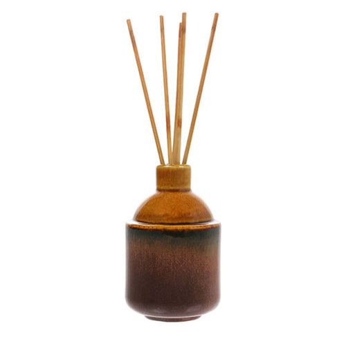 ochre yellow ceramic pot with wooden sticks for home fragrance