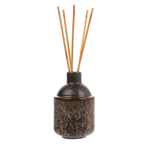 ceramic pot in dark colors with scented wooden sticks