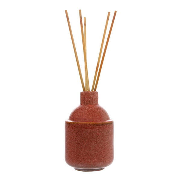 red ceramic pot with scented wooden sticks