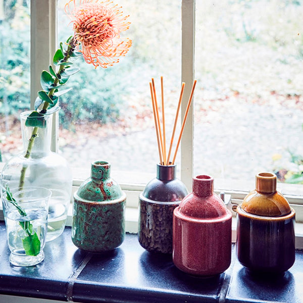 series of ceramic pots with scented sticks all together