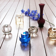 group of crystal glass candle stick holders on a wooden floor
