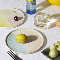 modern table setting with contemporary ceramics and crystal candle stick holder