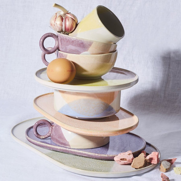 coffee ceramics in pastel colors on a stack