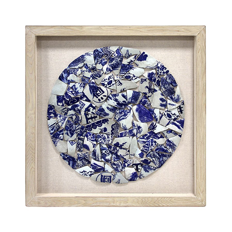 framed shattered blue and white porcelain in a circle with wooden frame