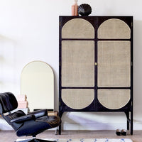 eames chair, retro black cane cabinet and arch shaped mirror with brass frame by HK living USA