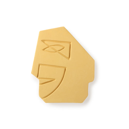 handmade mustard yellow wall ornament of a face