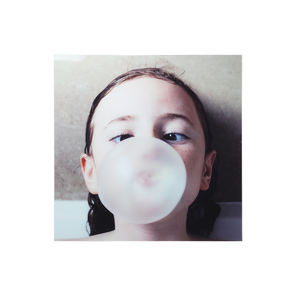 wall art imaage of girl blowing a bubble with bublle gum