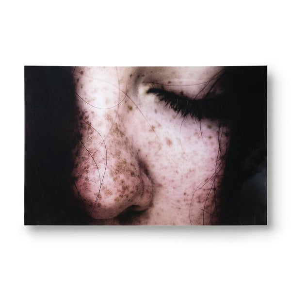 wall art of picture of face with freckles