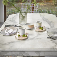 marble table top with ceramics in pastel colors