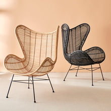 stylish image of rattan egg chairs in natural and black