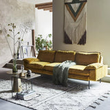 retro style inspired living room with brass side table and velvet ochre sofa by hk living usa