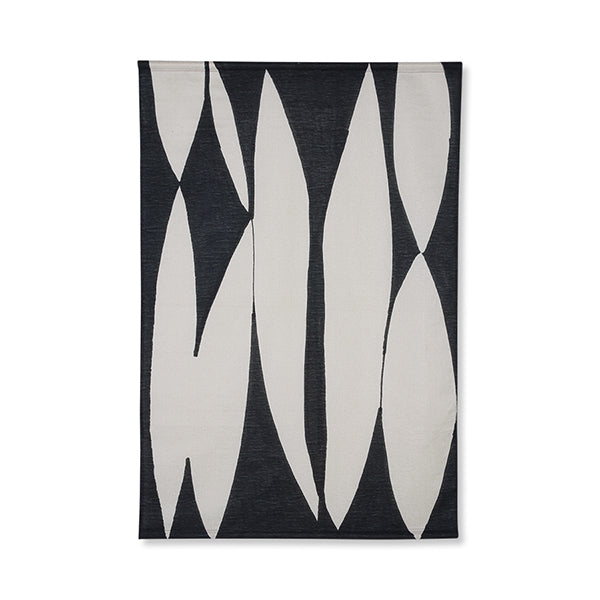 mid century modern wall tapestry made of cotton with a black and white abstract image