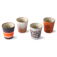 set of 4 ceramic cups in different colors and finishes suitable for coffee or succulent plants