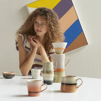 table with ceramic coffee mugs by hkliving