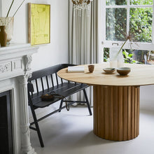 black bench at dining table