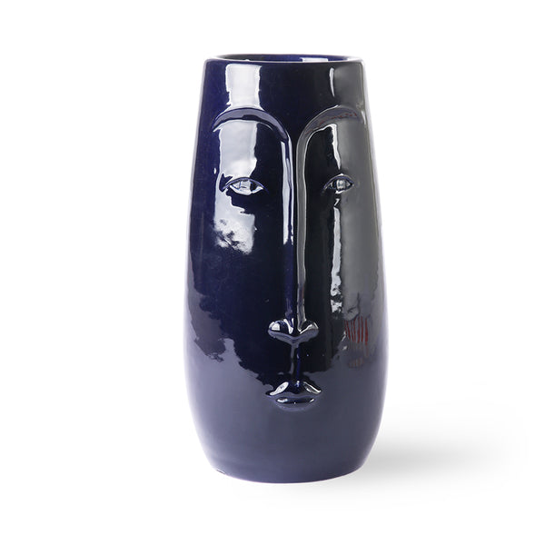 tall blue vase with face