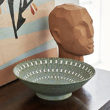 green bowl and terracotta head sculpture