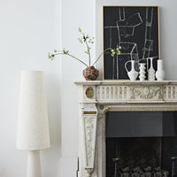 fire place mantel with hand brushed vase and black and white painting in frame