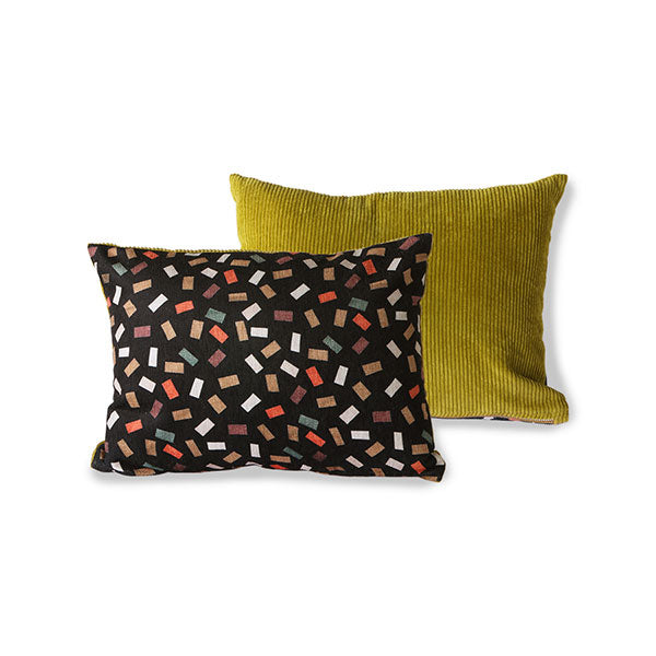 vintage look pillow with black and collared flakes pattern and green  corduroy back