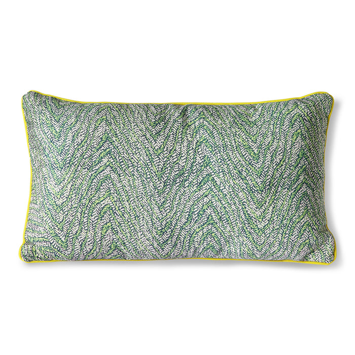green floral print pillow with yellow trim and zipper