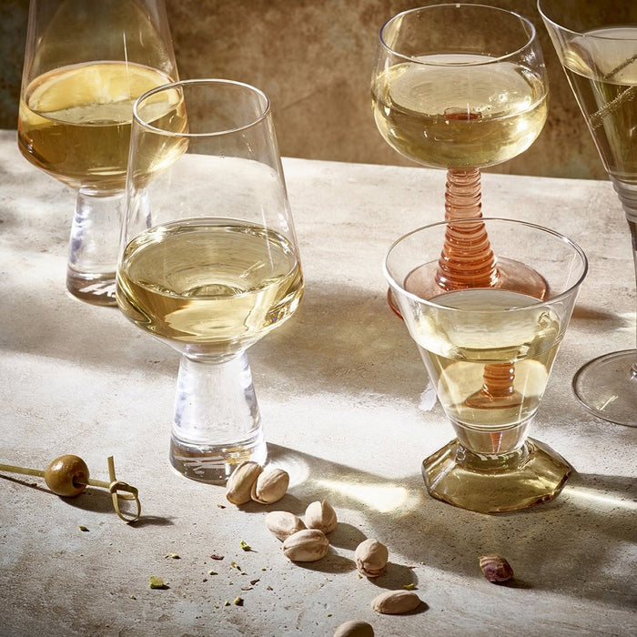 several glasses filled with wine on a table