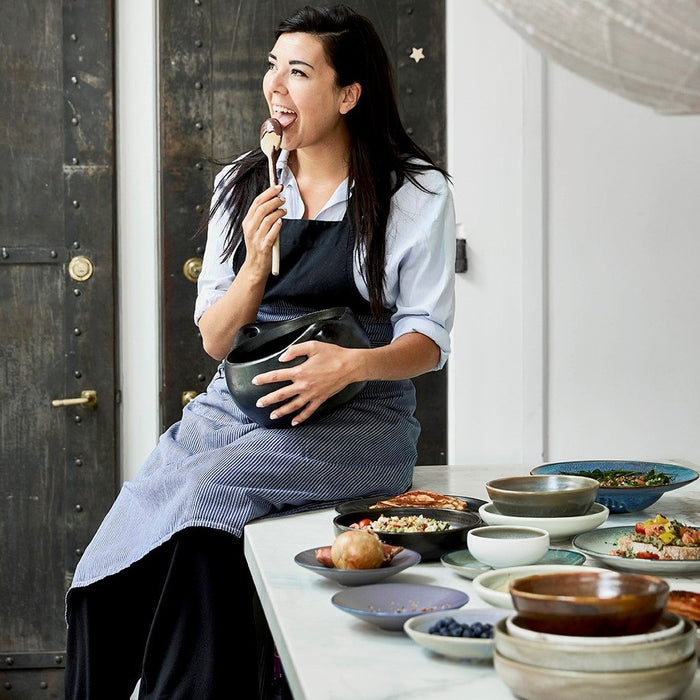 woman cooking in kitchen surrounded by hk-living ceramics