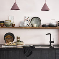 black rustic plates on open shelves