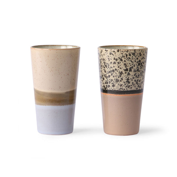 two skinny long ceramic mugs for latte with sand colors and a touch of orange and lilac