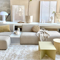 cream colored planter in a living room