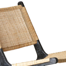 detail of black teak wood and natural cane webbing lounge chair