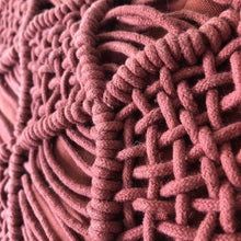 detail of coral red textured pillow