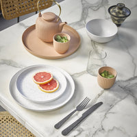 marble table with speckled ceramics and blush tray