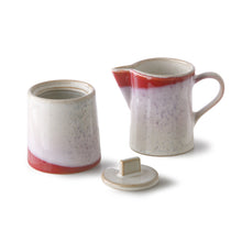 ceramic sugar pot and milk jug with red accents