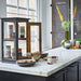 kitchen with marble counter top and black wooden display cabinet with mugs in retro design