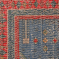 detial of cotton red and blue rug for bathroom