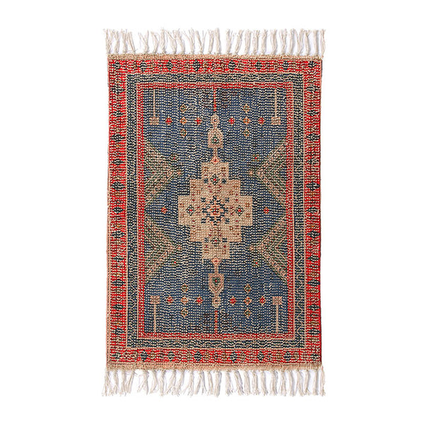 blue and red rug with fringes