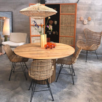 all natural room with wooden tale, rattan dining chairs, rattan pendant light and comfortable egg chair