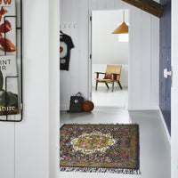 modern farmhouse style hallway with rose kelim rug, basketball, chair and hanging lamp