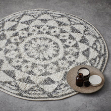 round rug with black and white hand screened pattern