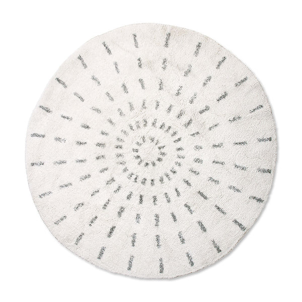 round rug with black and white swirl pattern