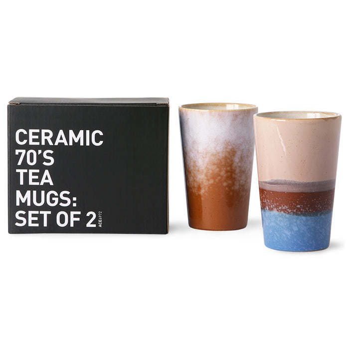 set of two tall ceramic tea mugs in blue and brown tones with a black gift box