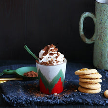 hot chocolate with whipped cream in a hkliving USA christmas mug