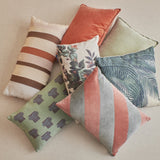 pile of pillows in soft colors