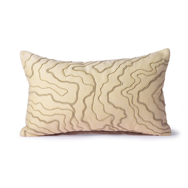 cream colored lumbar pillow with natural colored stitched lines