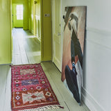 hallway with a pink, hand knotted woolen runner