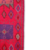 close up of a woolen runner in pink