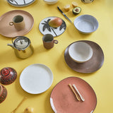 table setting with multi colored ceramics